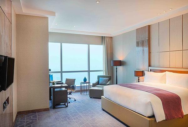 bedroom of luxury hotel suite in Hanoi