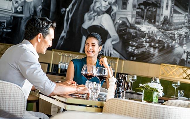a couple enjoying wine at Hanoi hotel